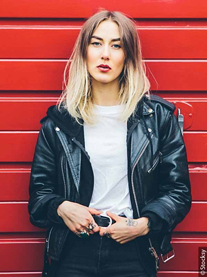Woman with ombré hair wearing leather jacket