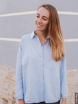 Woman in oversized shirt with ombré hair