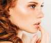 Red haired woman looking pensive