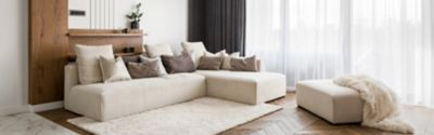 Living room with white carpet and sofa set