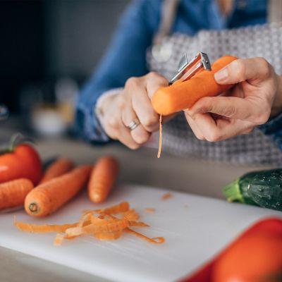 Lady peeling carrots
