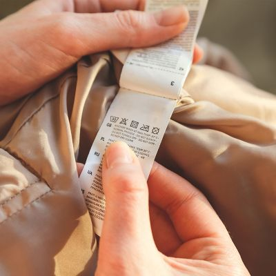 Person checking the clothing label