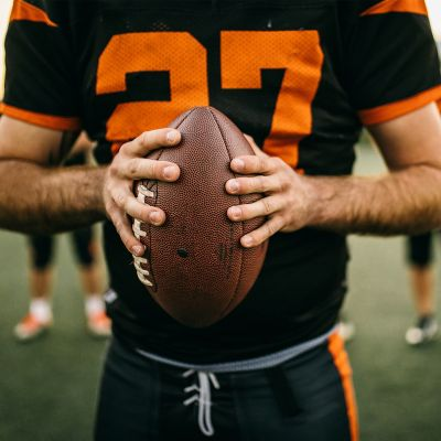 Athlete in Black Jersey holding  ball