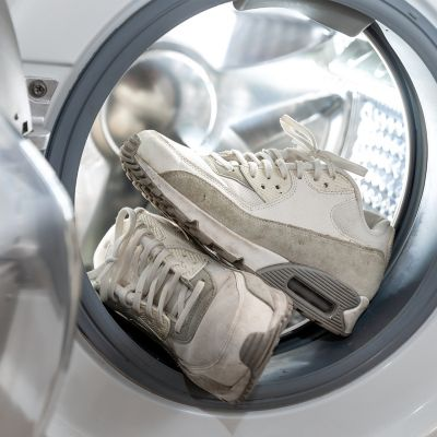 Pair of white shoes (Sneakers) in the washing machine