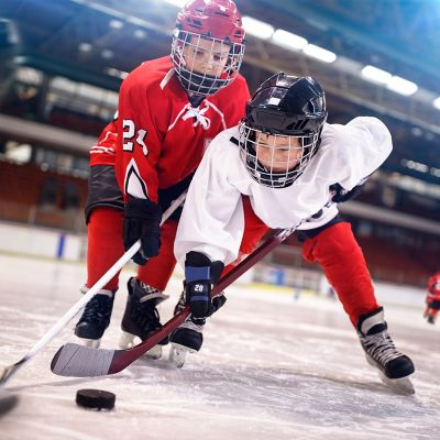 2 boys playing ice hockey