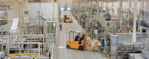 forklift moving a part inside an industrial manufacturing plant