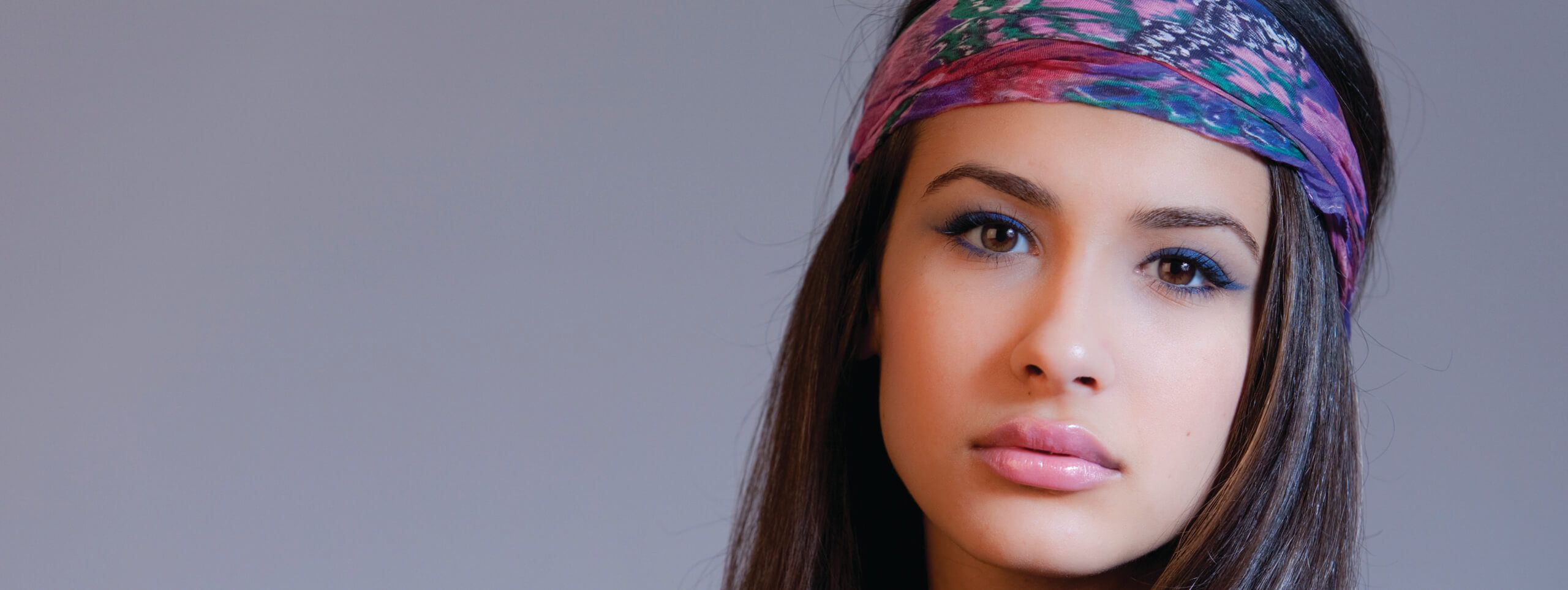 Woman with a very long hairstyle wearing a bandana