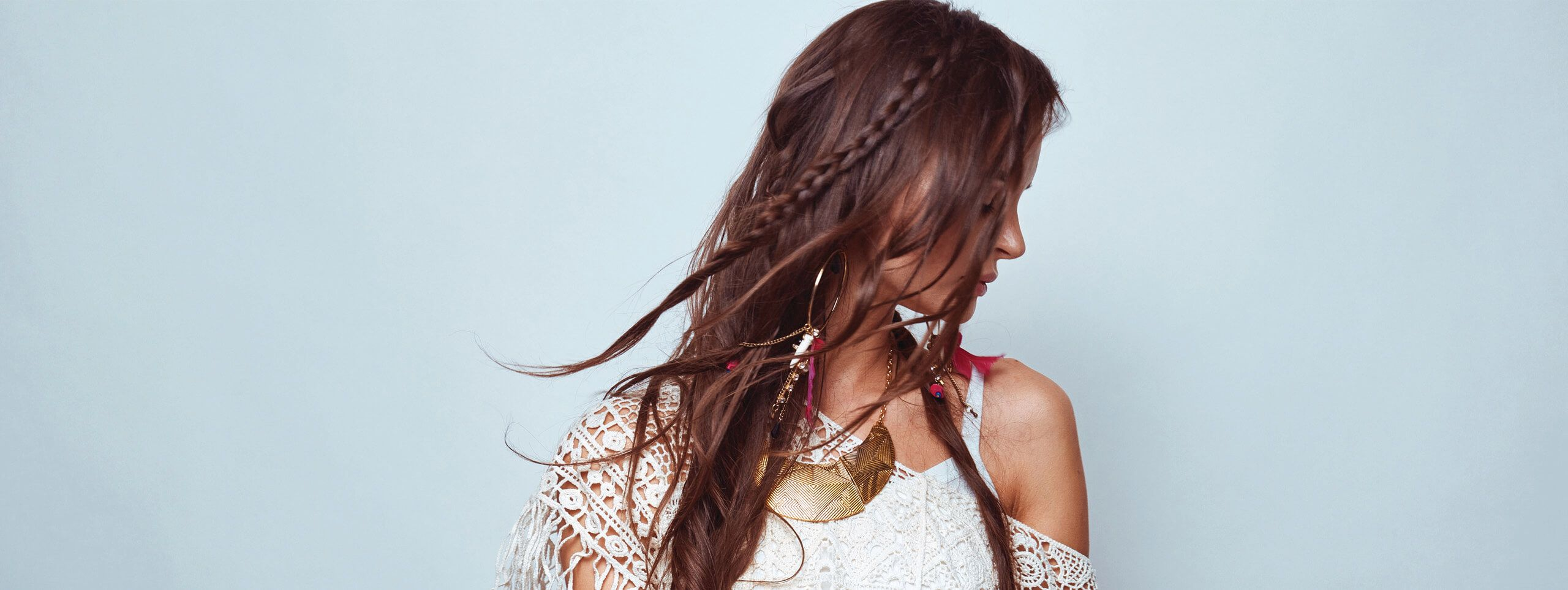 Model with long middle-parted hair and boho, wavy hairstyle