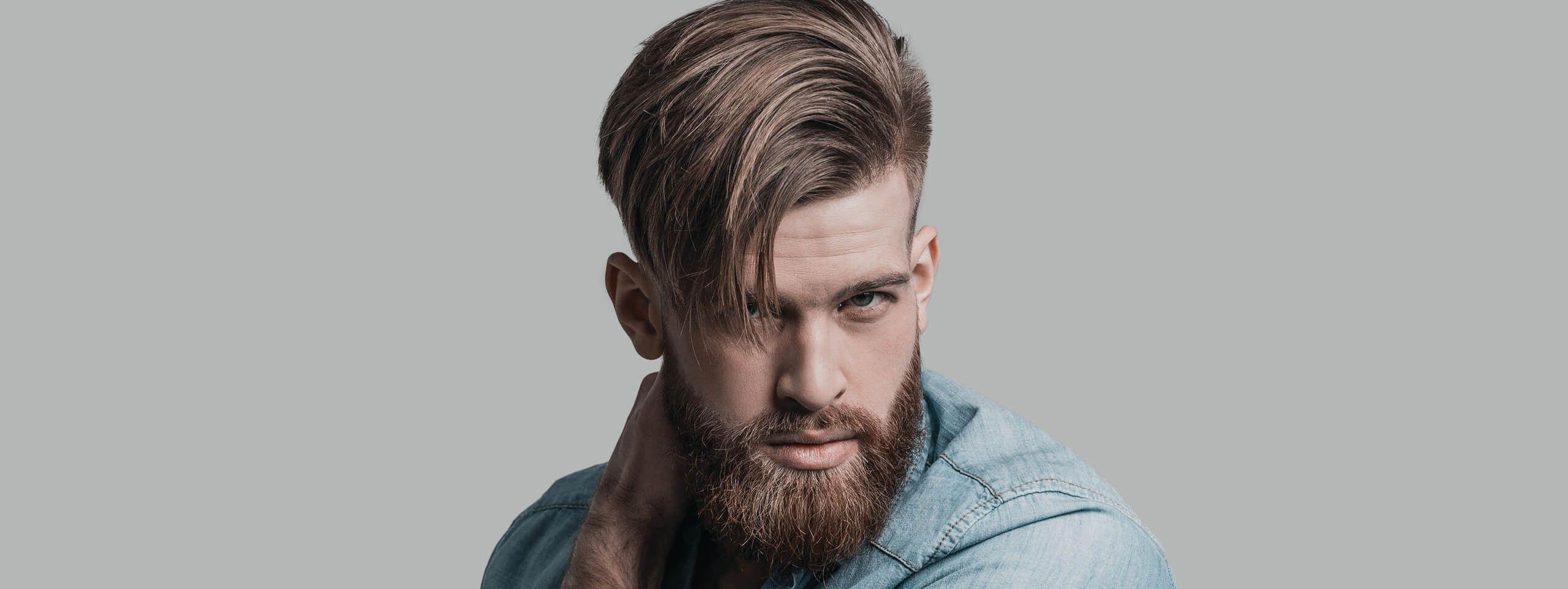 Ragazzo con undercut e barba