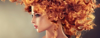 Blonde model rocks big curly hairstyle