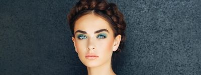 brown haired woman with colorful makeup