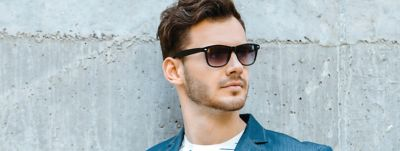 Man with stylish hairstyle and sunglasses