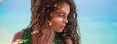 curly woman by the sea