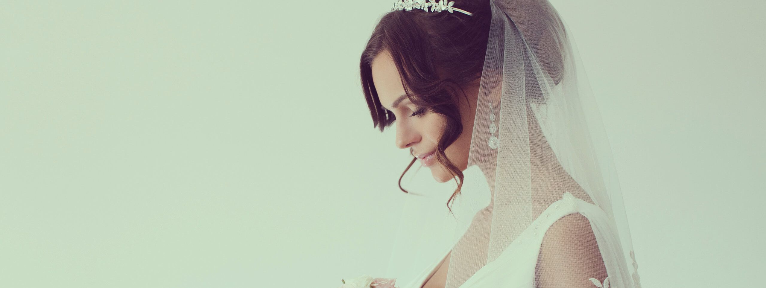 Model wears pretty updo hairstyle for wedding