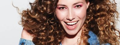 Women smiling with curly hair using Hair Gel Styling Gel