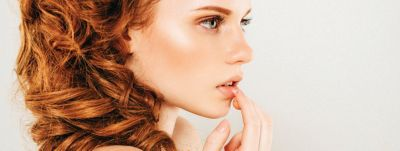 Detail of a nice young woman with red brown hair with wax