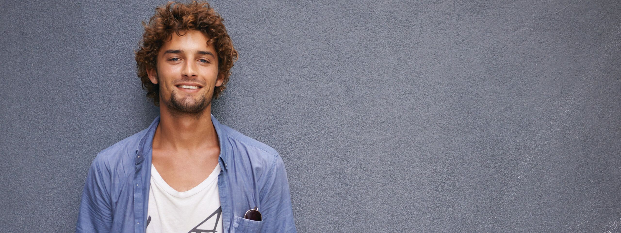 Male model with curly short hairstyle