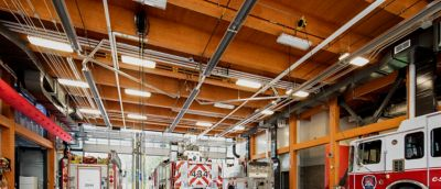 Interior of a fire station with a wood beam ceiling