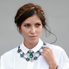 Brunette woman with milkbraids wearing big necklace