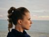 Woman with blondette hair at the coast