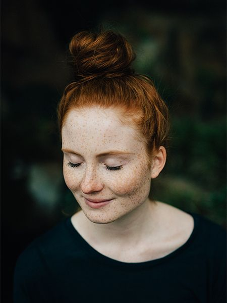 Woman with red hair in a bun