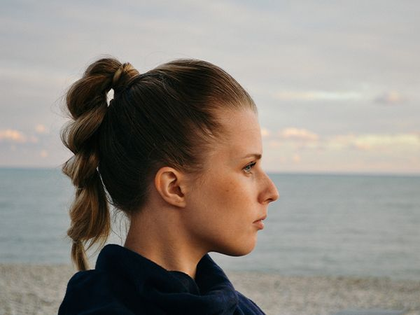 Woman with dark blonde braided hair