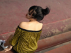 Woman with a high bun and bangs