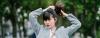 Asian woman making a ponytail