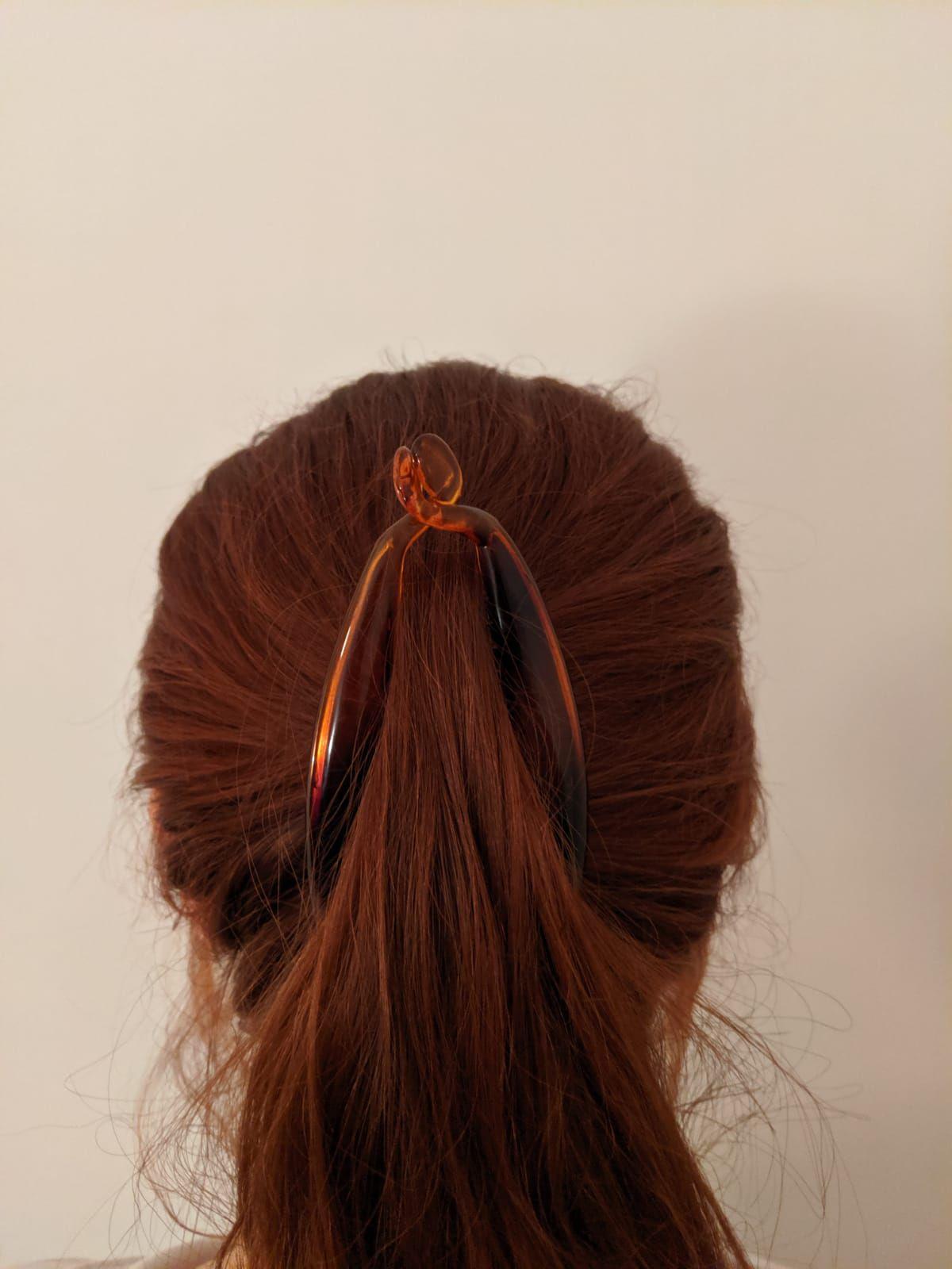 Back view of woman wearing banana hair clip