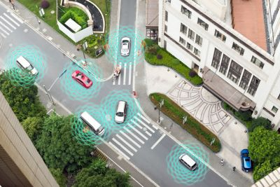 Illustration of autonomous self-driving vehicles in a city showing sensors