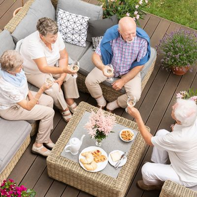 Best fabrics for outdoor furniture. A group of people sit on the deck.