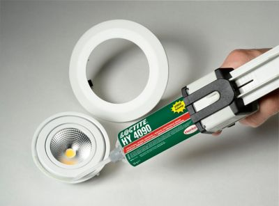 Applying a selected structural adhesive to a bulb housing