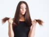 Brunette woman holding the ends of her hair