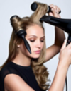 Woman blow-drying her hair and leaving the brushes stuck in