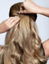 Woman adding bobby pins to hair