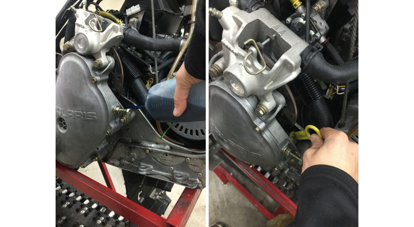 filling snowmobile with oil