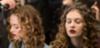 Women getting corkscrew curls styled