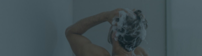 scalp care MID Payment Success Mobile image with man washing his hair