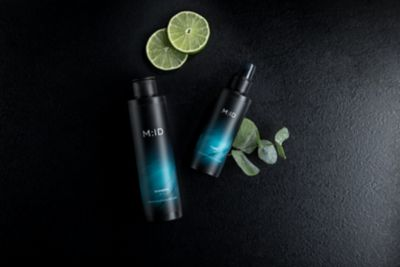 scalp care MID Stills Beruhigende Pflege products with lime on black background