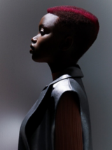 Essential Looks Artful Feeling Model With Red Coiled Curls Bob and Fringe