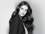 Fibre Clinix Black and White Image Model with Long Wavy Shiny Brunette Hair
