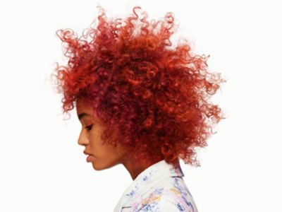 IGORA ROYAL REDS Model with Red Curly Hair