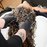 BLONDME Mellow Blonde Model With Tight Curly Brunette Bob Being Washed
