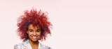 Artful Feeling Model With Red Coiled Curls Bob