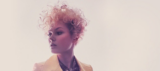 Essential Looks VivID Model With Short Curly Blonde Hair