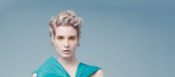 Everyday Decadence Model With Light Blonde Wavy Pixie Cut