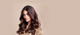 Oil Ultime Model with wavy, brown, shiny hair