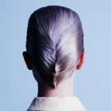 Magical Whimsy Model With Purple Rinse Pixie Cut Slicked Back