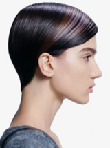 Back to Classics Side Profile Of Model With Sleek Brunette Pixie Cut