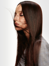 Back to Classics Side Profile Of Model With Long Straight Brunette Hair